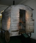 photograph: Gressenhall Farm & Workhouse: Museum of Norfolk Life. Accession No. GRSMR : NN377. Hut used at Yaxham, about 5 miles from Gressenhall. The interior is fitted with a bunk bed beneath which is a caged apartment for keeping sick lambs. It has a built-in folding table with a cupboard above for medicines, together with a small cast iron stove. © Rural Museums Network