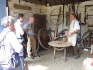 photograph: Mike Wright demonstrates wheelwrighting at Acton Scott © Rural Museums Network